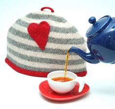 Love your tea and coffee pots and keep them toasty with this love heart wool tea cosy. $78.34