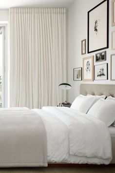 Master bedroom: full, to-ceiling drapes and a soft, neutral color palette. A calm place to end all your days.