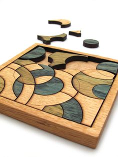 Blue and Green Circles Puzzle - Hand Colored Oak Pieces . Timber Green Woods. $27.95, via Etsy.