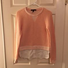 BCBG coral color sweatshirt in size XXS This Sweatshirt has white shirt details at the bottom, providing the illusion of two pieces. BCBG Tops Sweatshirts & Hoodies