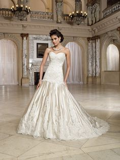 My Ideal dress. I like this style for its class and elegance. I love the mermaid style of the dress and halter would make me feel timeless. I would have my hair off to the side in a braided updo and accentuated with a beautiful jeweled hair comb.