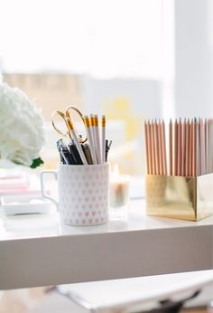 @Alaina Kaczmarski of The Everygirl // office space // white desk // heart mug from @west elm // gold pencil holder // photography by Stoffer Photography