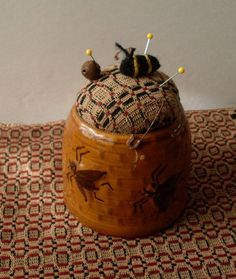PrimiTive Folkart Honey Pot Pincushion & by BeaconHillCollect, $29.00.      Going to try this myself.  Antique shopping here I come!