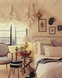 White washed wood bedroom. Slanted roof