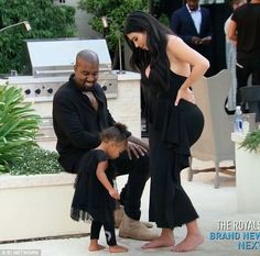 Family affair: Kim attended the graduation party with husband Kanye West and daughter Nort...
