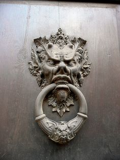 Scary door knocker, Rome - photo by  Kevin Triplett (looks like it's based on the Green Man theme. They frequently look fierce but this guy is really mean looking)