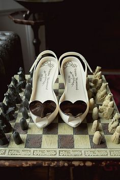 Jenny's Vivienne Westwood shoes on a chess board. These heels are like grown-up jelly shoes and come in tons of colors. http://offbeatbride.com/2011/08/monday-montage-shoes-dogs