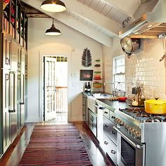 galley kitchen with subway tiles, wood floors and beamed ceilings