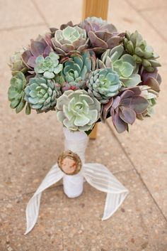 succulent wedding bouquet... love this idea minus the wrapped and pinned stems