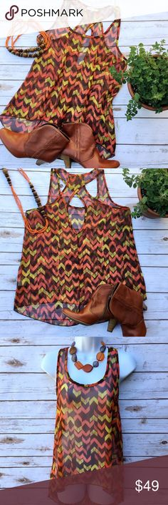 Sheer Hi-Lo Chevron Print Festival Tank Top Wear it over a tube top or as a swimsuit cover up. 100% polyester top in a brown, orange, and yellow color scheme. Size L, measures about 18.5 inches from armpit to armpit and 24 inches in length in front and 29 inches in back. Edge Tops