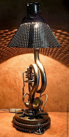 Steampunk Table lamp with Clock and Day of the week Timer by an arrow in the middle of the holes in the base of the lamp...