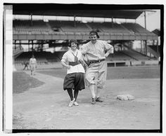 """Girls baseball. Washington fans are strong for """"Uncle Nick Altrock"""" and therefore the War Risks have Dot Meloy in training as a side line entertainer. Nick is teaching her a few of his stunts: photo by National Photo Company, 10 June 1920 (National Photo Company Collection, Library of Congress)"""