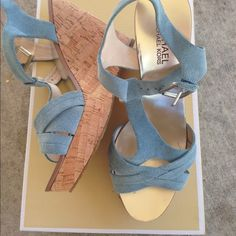 """Michael Kors wedges Only worn about 4x, light blue suede straps, 4 3/4 """" wedge, the only flaw is pictured which is one of the straps the suede has come of s bit, other than that in great condition, the bottoms look hardly worn, size 7 but a 6.5 could possibly fit, NO TRADES, please use offer button to negotiate Michael Kors Shoes Wedges"""
