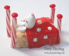 Sleeping on a Rice Krispie Treat, this little Jordan Almond mouse is dreaming of Christmas. With Smarties candies as ears, a fruit roll up blanket and peppermint stick bed posts, this little cutie is just too sweet to eat.