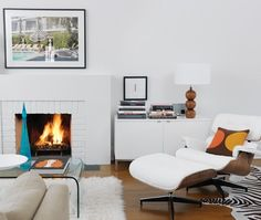 White cabinets were placed on either side of this fireplace to hide electronics, CDs and photo albums.