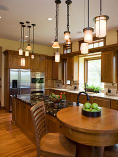Unique pendant lighting adds warmth and character to this craftsman kitchen.