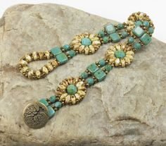 SUPERDUO CZECHMATE TILE Flower Bracelet-Dark Turquoise Picasso-White Picasso-Toho Seed Beads-TierraCast Tree of Life Button-(SD131) by CinfulBeadCreations on Etsy https://www.etsy.com/listing/253138907/superduo-czechmate-tile-flower-bracelet