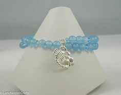 Scorpio star sign bracelet featuring real aquamarine gemstone beads and a silver plate charm. http://lanchestercrafts.org/product/scorpio-star-sign-gemstone-bracelet-handmade-featuring-silver-zodiac-charm/