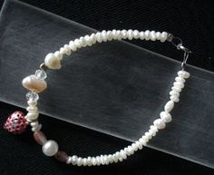 Hand made bracelet of fresh water pearls and silver 925 heart with cold enamel and  liquid glass Made by Eirini Svarnia Price 35.00 euro