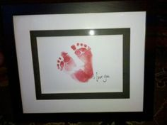 "I made this for my husbands first fathers day present from our son. All I needed was a red ink pad, scrapbook paper, and a frame. I stamped his feet and tried to get it so it looked like a heart then wrote ""I Love You"" on it. Total cost was less than $20."