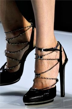 Dior Black python sandal with corset laced chains.