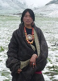 Tibetan man in traditional amber and coral jewelry.