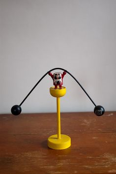 I LOVE this little guy. And maybe he could get me clean up my desk?   Vintage Japanese Balance Toy.