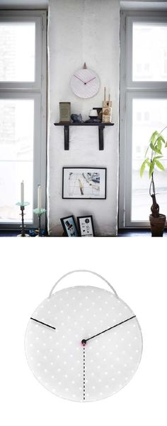 The face of the IKEA PS 2014 wall clock constantly changes. The hour hand is a revolving transparent disc, with a pattern that creates playful shadows.