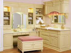 A spacious cream vanity with matching stool offers plenty of storage space while also serving as a place for getting dressed and putting on makeup.