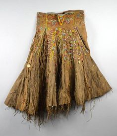 Africa   Ceremonial skirt from the Iraqw people of northern Tanzania   Girls reportedly fabricate leather skirts for themselves during a period of seclusion prior to marriage, decorating them with beads and, on occasion, recycled materials such as discarded keys and other bright odds and ends. However, adult women are also known to participate in the beading of skirts and will wear them along with younger members of the community on ceremonial occasions.