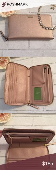 "25% Off Kate Spade Large Travel Wallet Rose Gold Brand New! Kate Spade Travel Wallet in Rose Gold. Material Crosshatch Leather with matching trim. 14k Gold Plated Hardware. Description: Zip Around Wallet 11 credit card slots. Interior zip change pocket. ID window and Pen Holder. Slide pocket for boarding passes and passport. Size: 4.4""H x 7.8""W x 1""D kate spade Bags Wallets"