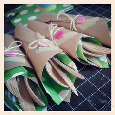 Fun table utensil wraps created using washi taped paper napkins