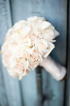 love the white roses and crystal embellishments