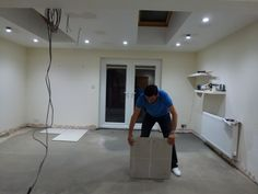 laying of porcelain tiles - Colella Interiors kitchen installation process