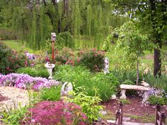 Gardens We Love From Rate My Space: Here's a gardener that obviously loves her craft. Besides this memory garden with several spots for reflection, she's filled up a lot of her yard with many other garden spaces. (Garden by  contributor Deronda) From DIYnetwork.com