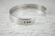 I am...The Heroine in My Own Life Story Secret Message Hand Stamped Cuff Bracelet Can Be Custom Quote. $26.00, via Etsy.