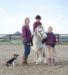 Mother with her daughters and their pony.  by hughsitton | Stocksy United #authenticwoman #realwoman