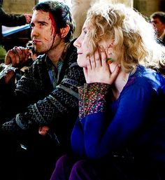 Neville Longbottom and Luna Lovegood. I <3 Nev's face in this!