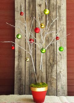 Make a merry topiary tree using a painted terra cotta pot, a can of insulating foam sealant and some decorative branches. Click through for the how-to at The Home Depot Garden Club.