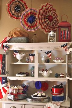 Eve, my Goodwill hutch is all set for some summer fun in a patriotic rustic Americana theme.   Of course, I have to start with Milk Glass. I love to collect vintage pieces of Milk Glass and almost always buy it when I see it at Goodwill. I've got quite a collection.  Eve will stay decorated in this patriotic decor throughout the entire summer. The only items I will switch out are the snacks.  This hutch is perfect for decorating all year long.