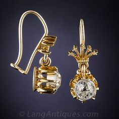 late-19th century antique earrings feature bright and dazzling mine-cut diamonds weighing just a tad under one carat total