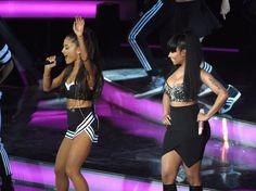 Ariana Grande and Nicki Minaj perform together.