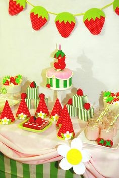 Dessert Table    		This is a strawberry shortcake themed birthday dessert table that I  did for my daughter's 3rd birthday. All of the decorations, including  favor boxes and party hats, are handmade by me using fabric, paper and  felt. (The felt strawberries are courtesy of Kim Nario - The Eggplant  Garden) Featuring strawberry and daisy sugar cookies decorated with  strawberry flavored
