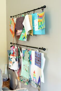 curtain rods and drapery rings to display kids art.