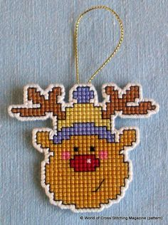 This very cute Rudolph from World of Cross Stitching Magazine was perfect for creating a hangable Christmas tree decoration. I made this one in cross stitch on a 14ct plastic canvas square using DMC stranded cotton. Then I cut very carefully around Rudolph leaving one line of canvas intact all round, which I oversewed in white perle.