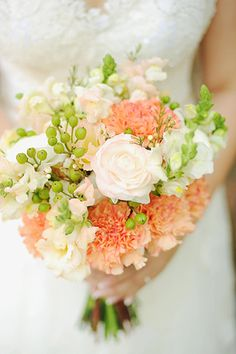 Roses and carnations were fashioned into a pretty bouquet for the bride. | www.BridalBook.ph #weddings #bouquet