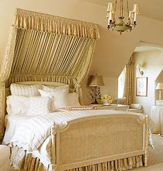 Fairytale Fabrics:   There's something about abundant draping that appeals to the girl in all of us. Even the double-layered bedskirt in this Southern Accents bedroom looks like a petticoat peaking out from a skirt.