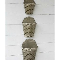 """These Hanging Metal Olive Buckets are full of vintage flair. Fill them our cotton stems or florals for a seasonal look. Sold as a set of three. - Small measures: 9.5""""W x 12""""T x 5""""D - Medium measures:1"""