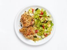 Sesame-Lemon Chicken : With a rub made from sesame seeds and lemon zest, chicken thighs become the centerpiece of this healthy main dish, which includes a simple lettuce and tomato salad.