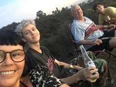 Can we all just take a moment to see that troye is holding a beer bottle AND a wine glass
